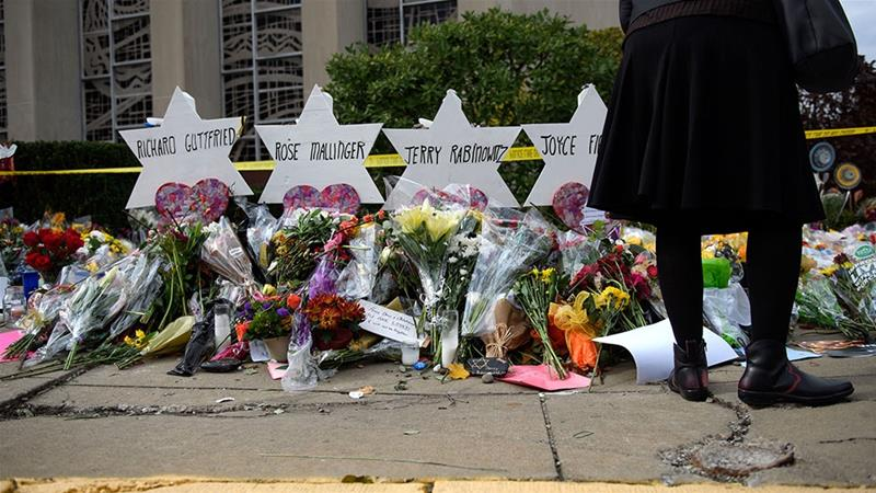 Mourners visit the memorial outside the Tree of Life Synagogue in Pittsburgh, Pennsylvania [File: Jeff Swensen/Getty Images/AFP]
