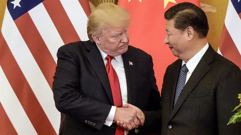 President Donald Trump with China's President Xi Jinping in Beijing last year [Fred Dufour/AFP]
