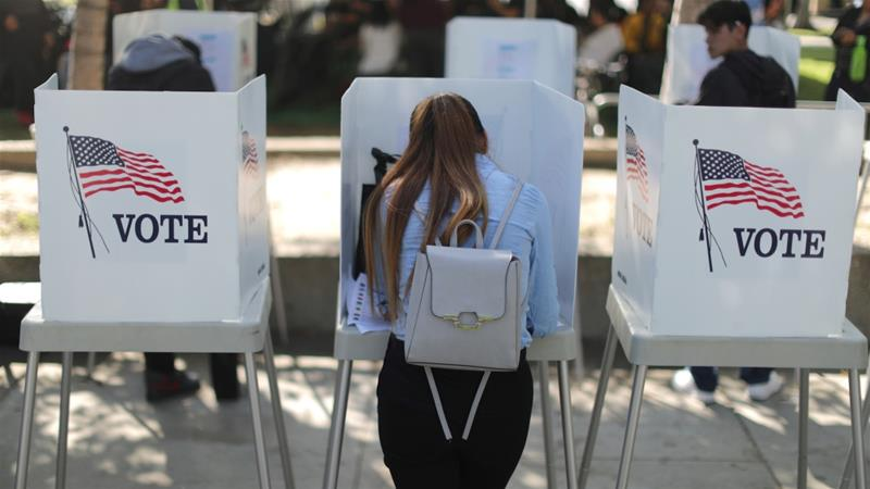 Desteny Martinez, 18, votes for the first time, in the US congressional and gubernatorial midterm elections in Norwalk, California [Lucy Nicholson/Reuters]