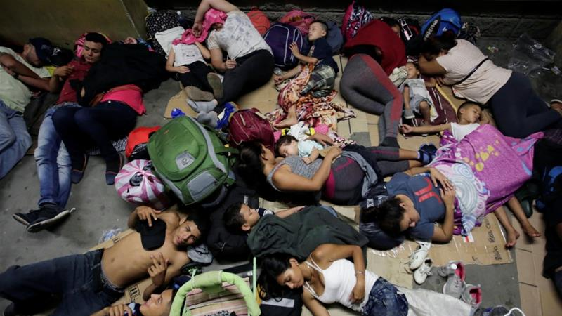 Hondurans fleeing poverty and violence, rest before moving in a caravan towards the United States, outside the bus station in San Pedro Sula [Jorge Cabrera/Reuters]