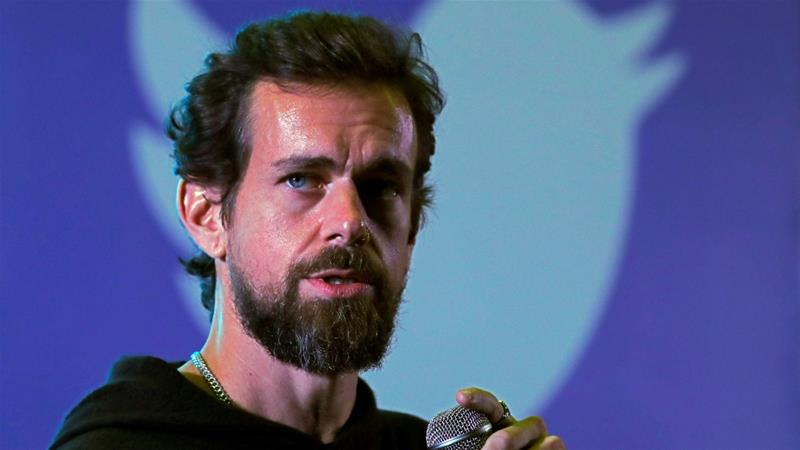 Twitter India said the poster was handed to Dorsey by a Dalit activist when it hosted a closed-door discussion with a group of women [Anushree Fadnavis/Reuters]