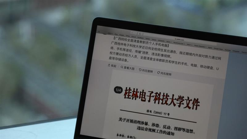 A computer shows the leaked online post from Guilin University of Electronic Technology warning of 'hostile domestic and foreign powers' [Ng Han Guan/AP]