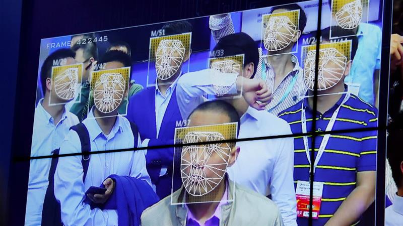 Visitors experience facial recognition technology at the China Public Security Expo in Shenzhen last month [Bobby Yip/Reuters]