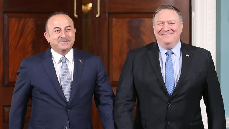 Cavusoglu (right) said Ankara handed the list to US officials after meeting with Pompeo [AFP]