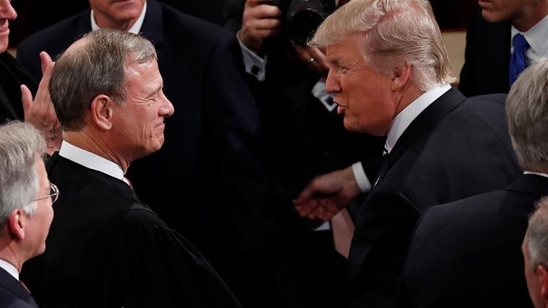 President Donald Trump greets Chief Justice John Roberts on Capitol Hill [Pablo Martinez Monsivais/AP Photo]