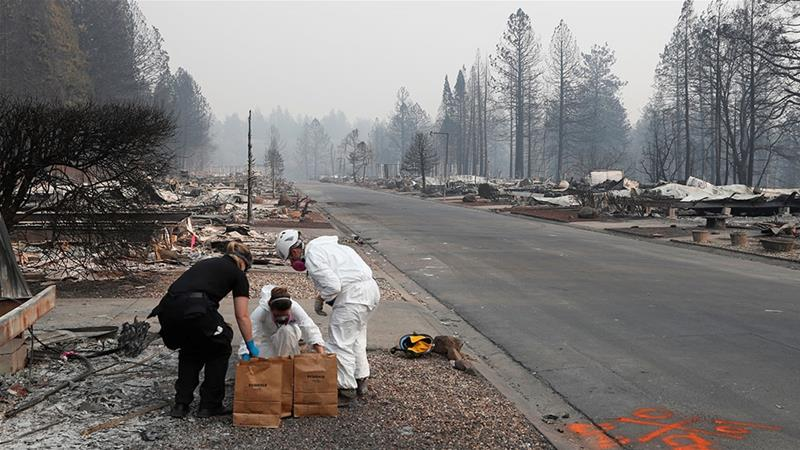 San Mateo County Deputy Coroner Elizabeth Ortiz works with forensic anthropologists to recover human remains from a trailer home destroyed by the Camp Fire [Terray Sylvester/Reuters]