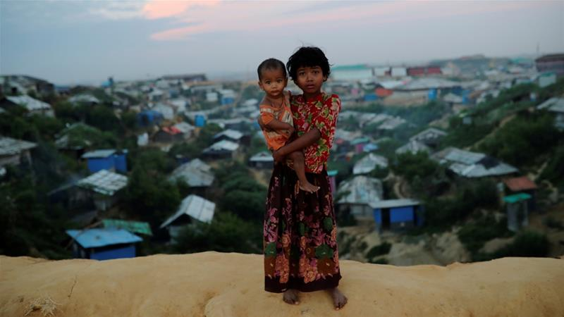 Over 700,000 Rohingya live in sprawling refugee camps in Bangladesh after fleeing a brutal crackdown by Myanmar forces last year [Mohammad Ponir Hossain/Reuters]