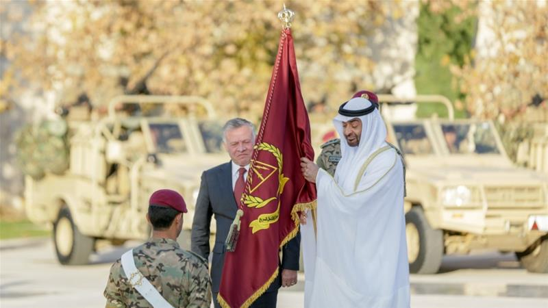 Jordan's King Abdullah II presents Abu Dhabi crown prince with the new brigade flag [Jordan's royal court]