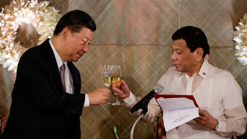 China's President Xi Jinping and Philippine President Rodrigo Duterte toast during a State Banquet at the Malacanang presidential palace in Manila on November 20 [Mark Cristino/Reuters]