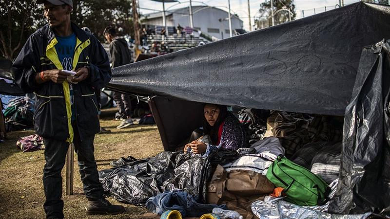 Central Americans remain at a shelter near the US-Mexico border fence in Tijuana [File: Pedro Pardo/AFP]