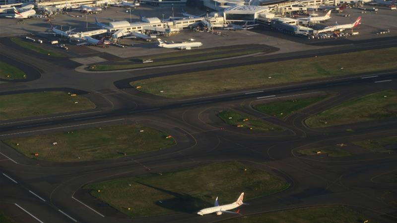 Major delays at Sydney Airport as wind cuts services