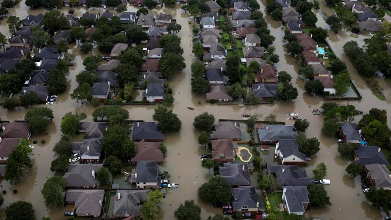 In this 2017 photo, houses are seen submerged in flood waters caused by Tropical Storm Harvey in Texas [Adrees Latif/Reuters]