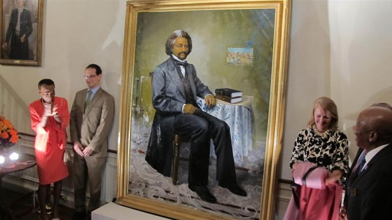 A portrait of Douglass is unveiled at the Maryland governor's residence in Annapolis, Maryland, the state where Douglass was born [Brian Witte/The Associated Press]