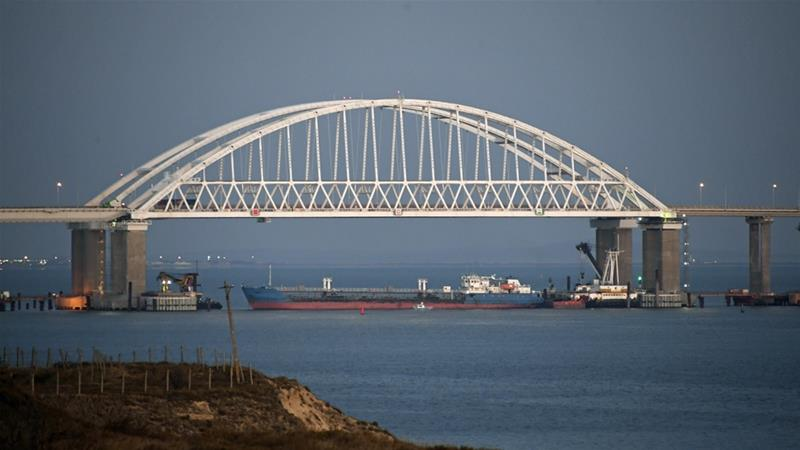 Moscow placed a large cargo ship beneath the Crimean Bridge, blocking the only passage into the Sea of Azov[AP Photo]