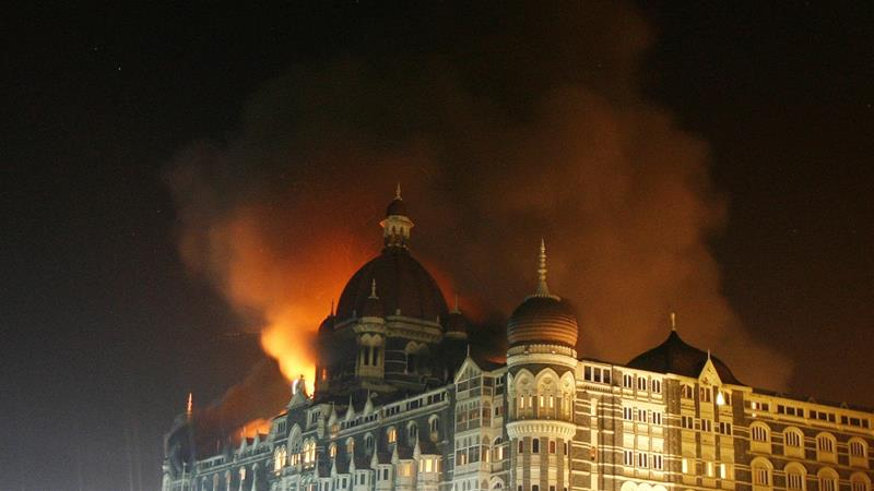 Smoke rises from the Taj Hotel in Mumbai November 27, 2008 after gunmen launched a series of attacks in India's financial capital Mumbai [Reuters/Arko Datta]