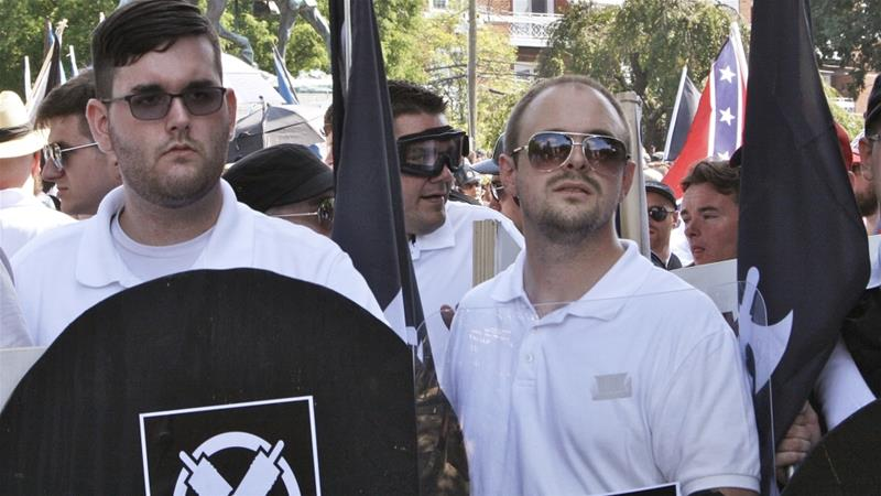 James Alex Fields Jr, left, holds a black shield in Charlottesville where a white supremacist rally took place [Alan Goffinski/AP Photo]
