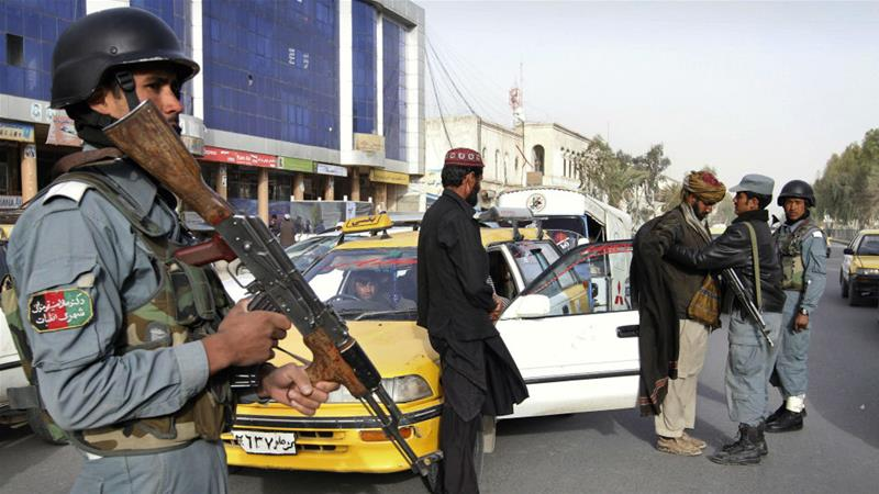 Witnesses say Afghan police fired on protesters but the interior ministry denied the claims [Allauddin Khan/AP]