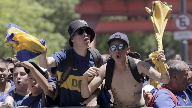 Boca Juniors fans gather outside the hotel where their team is staying in Buenos Aires, Argentina [Ana Mombello/AP Photo]