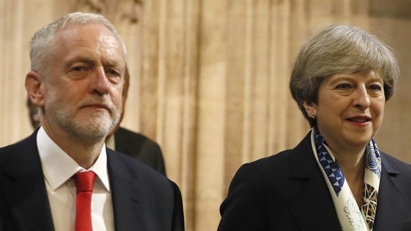 This will be the first time May (R) and Corbyn (L) will participate in a debate on live TV [Kirsty Wigglesworth/AP]