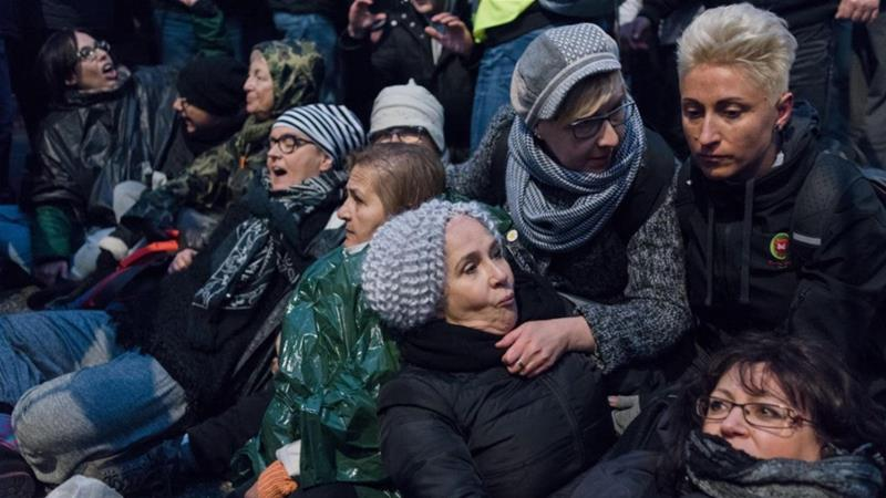 "14 Polish women who opened a banner saying ""Stop fascism"" during a far-right march in Warsaw on Nov 11 2017 were attacked [Tomasz Stephien/Oko.Press via Amnesty]"