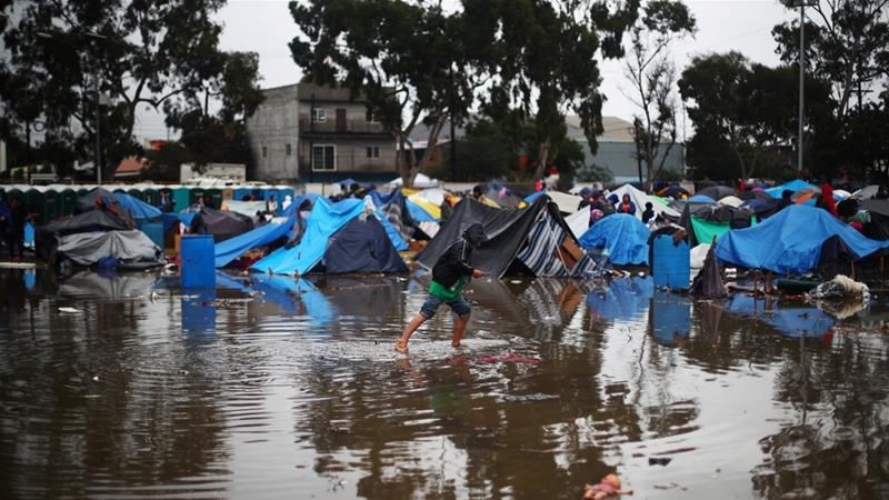 Heavy rain turns Tijuana asylum seeker camp to mud