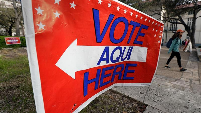A sign directs voters to a Texas primary election polling site on the University of Texas campus [File: Eric Gay/AP Photo]