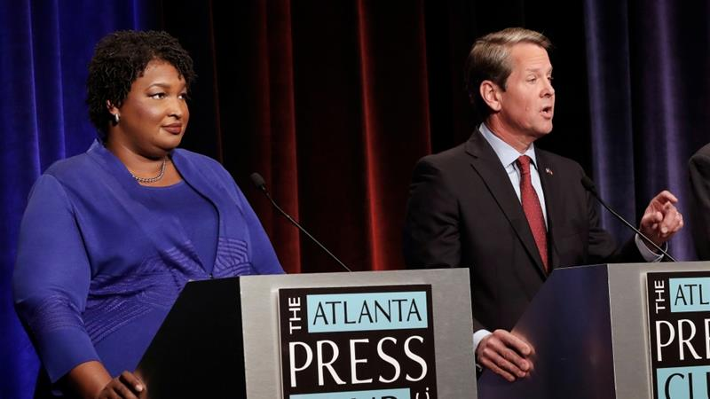 Stacey Abrams (left) is running against Republican Brian Kemp (right) for Georgia''s governorship [Reuters]