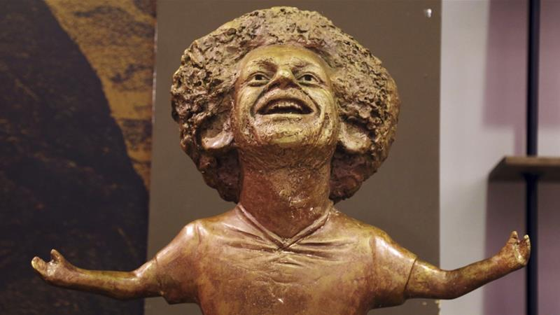 The bronze artwork depicts Salah performing his trademark goal-scoring celebration [Ayman Aref/AP]