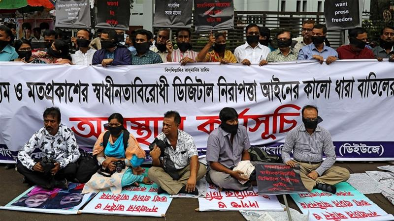 Journalists hold banners and placards as they protest against the newly passed Digital Security Act in front of the Press Club in Dhaka, Bangladesh, October 11, 2018 [Mohammad Ponir Hossain/Reuters]
