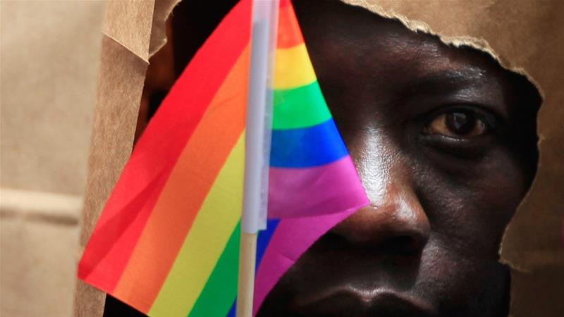 An asylum seeker from Uganda poses as he marches with the LGBT Asylum  Support Task Force