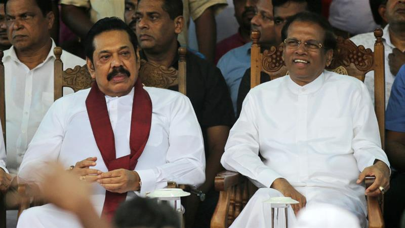 President Maithripala Sirisena, right, and newly appointed Prime Minister Mahinda Rajapaksa attend a rally on Monday [Eranga Jayawardena/AP]