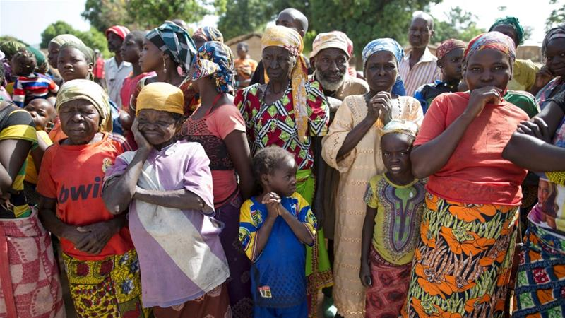 Women stand in line for food aid distribution delivered by the UN in the village of Makunzi Wali [File: Baz Ratner/Reuters]