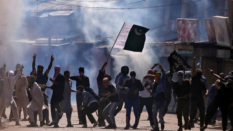 Demonstrators hurl stones towards Indian security forces during a protest in Srinagar [File: Danish Ismail/Reuters]