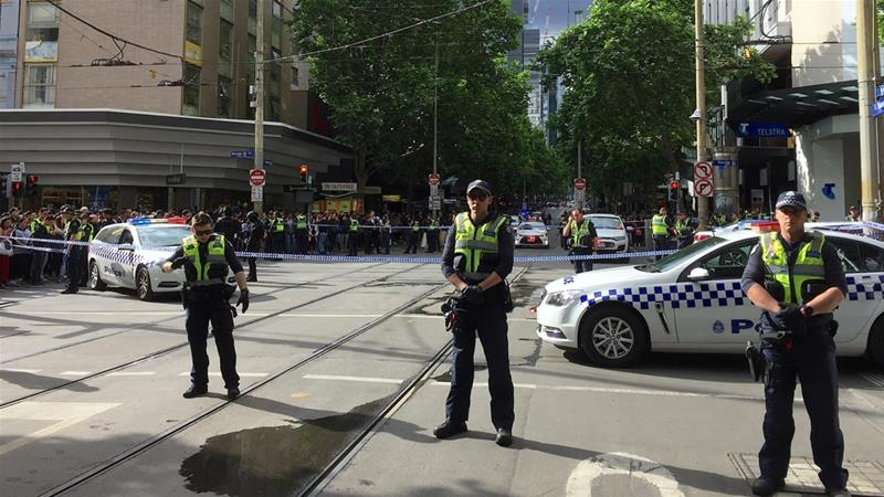 Melbourne attacker swings knife at police, 'trolley man' helps officers