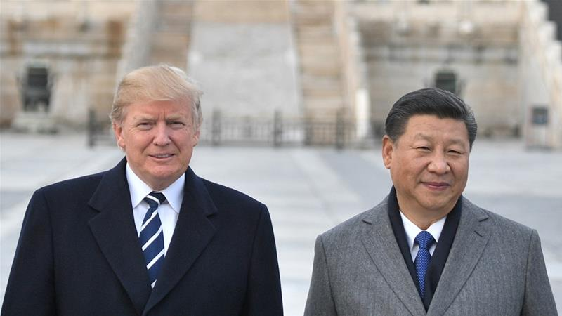 Trump expects concessions from Xi, after lamenting  the US trade deficit of $336bn last year [Jim Watson/AFP]
