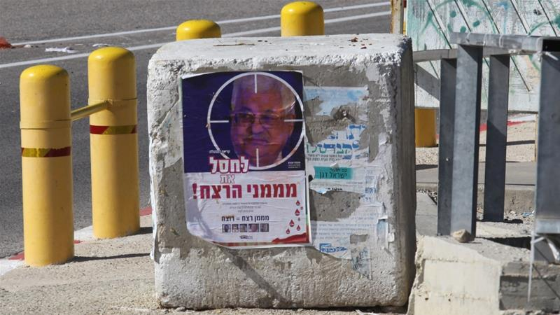Settlers put up posters calling for the assassination of President Abbas reading 'kill the financier of terror' [Al Jazeera]