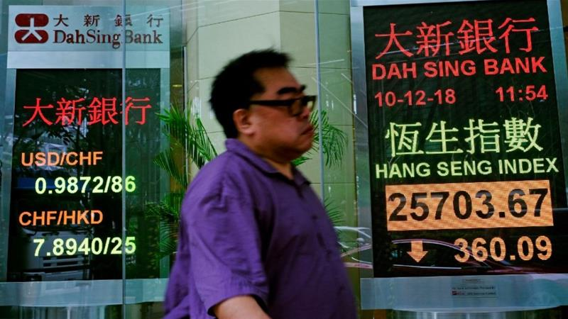 Global markets are nervous about a collision between the world's two largest economies [Vincent Yu/AP]