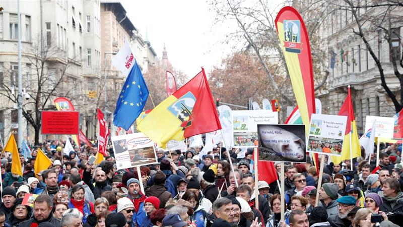 Hungary: Lawmakers OK labor rule changes seen as 'slave law'