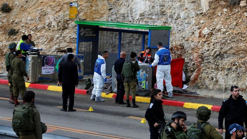 Israeli forces and medics at the scene of a shooting attack near Ramallah in the Israeli-occupied West Bank [Ammar Awad/Reuters]