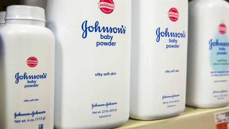 Bottles of Johnson & Johnson Baby Powder line a chemist shelf in New York [File: Lucas Jackson/Reuters]