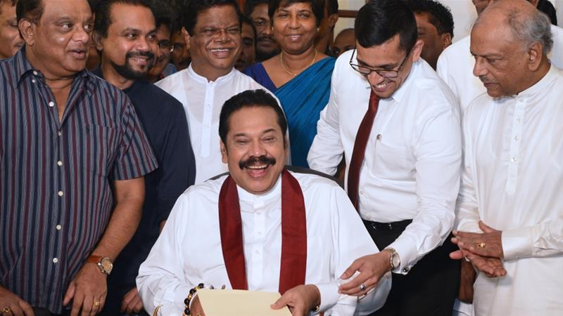 Mahinda Rajapaksa signed his resignation letter in front of journalists and party members [Lakruwan Wanniarachchi/ AFP]