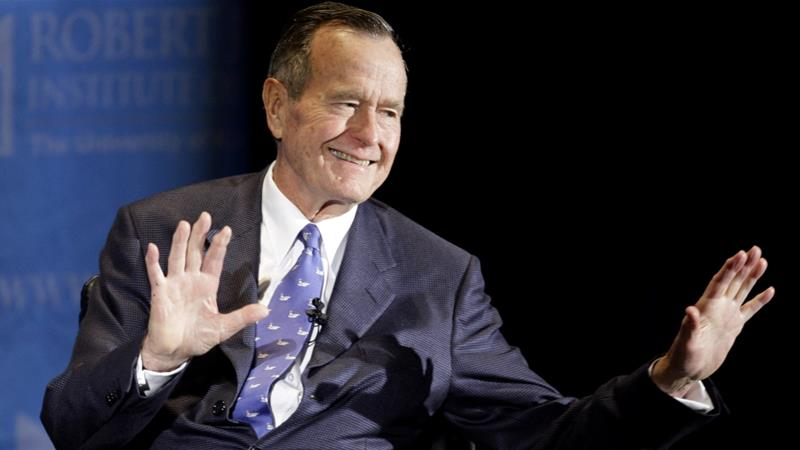 Cutting through the bush of media's posthumous propaganda is not about disrespecting George HW Bush in his death, but about respecting the lives of those victimised by his policies, writes Kanji [AP]