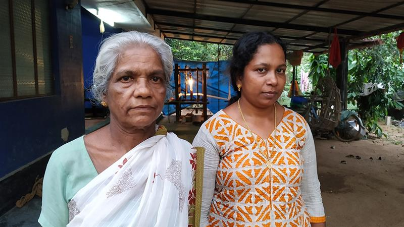 Ammini and her daughter-in-law Sujitha at Ammini's home, which is yet to be repaired following the floods [Jithin Shamsu/Al Jazeera]