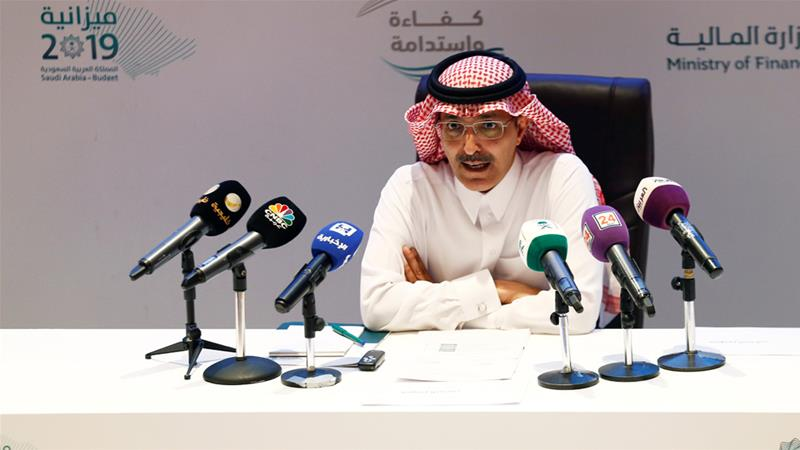 Mohammed al-Jadaan speaks during a news conference in Riyadh on Tuesday [Faisal al-Nasser/Reuters]