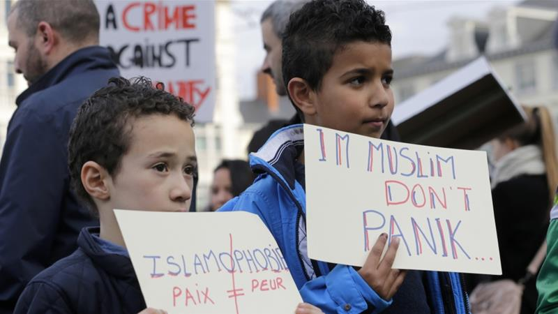 Two boys show signs during a protest against Islamophobia in Brussels, Sunday, October 26, 2014 [FILE: Yves Logghe/AP]