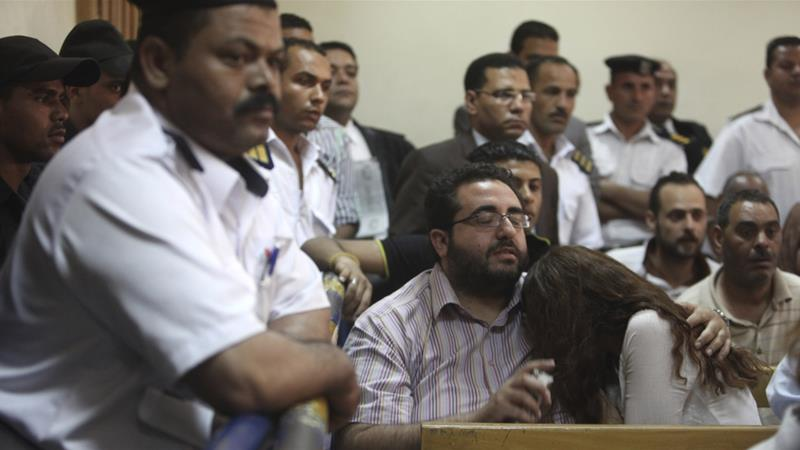 In this file photo from 2013, friends of Egyptian suspects listen to the judge's verdict during a case against foreign NGOs [File: Asmaa Waguih/Reuters]