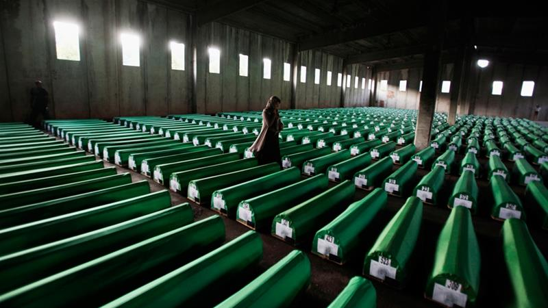 A Bosniak woman searches for the coffin of a family member ahead of the mass burial held every July 11 on the anniversary of the Srebrenica genocide [Dado Ruvic/Reuters]