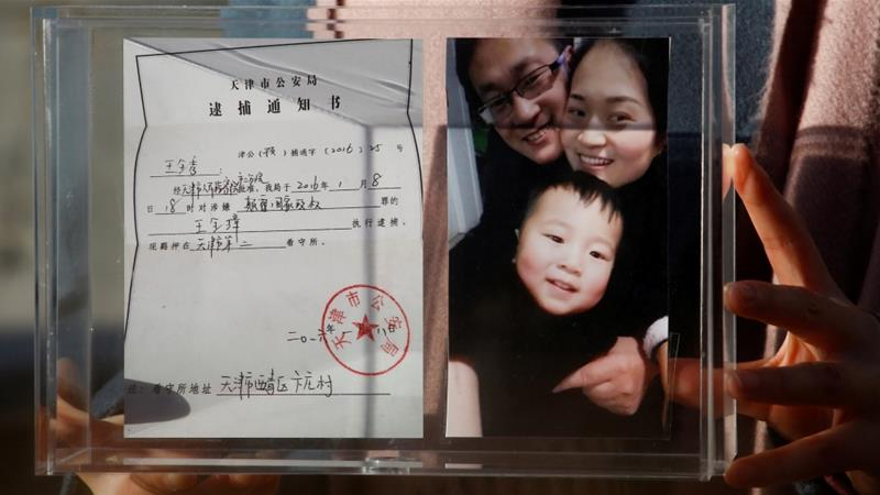 A picture showing Wang Quanzhang's family and his detention notice [Thomas Peter/Reuters]