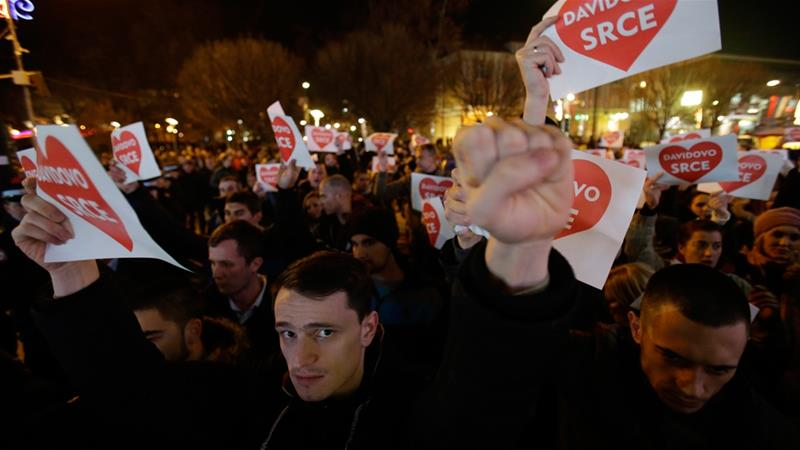 Protesters hold banners reading 'David's Heart', during a peaceful demonstration in Banja Luka, Bosnia in support of David Dragicevic [Amel Emric/Associated Press]