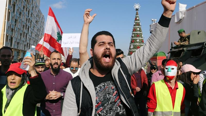A man takes part in a protest over Lebanon's deteriorating economy and political instability [Mohamed Azakir/Reuters]